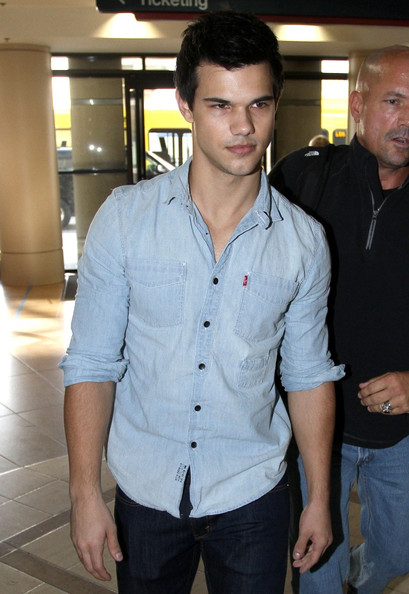 Taylor Lautner looks tired as he prepares to depart from Los Angeles International Airport (LAX).