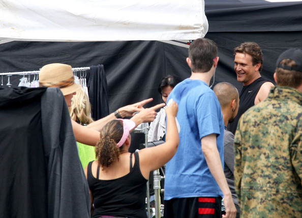 "Leslie Mann takes direction from her husband, Judd Apatow, as she and Jason Segel film ""This is 40."" Mann keeps her fair skin shaded by carrying an umbrella when the cameras aren't rolling."