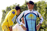 "Lance Armstrong stands proud after making a comeback to cycling at the Tour de France. Standing next to him on the podium is Alberto Contador, winner of the tour. Members of Lance's family, mother Linda Mooneyham and his children Luke (b. October 1999), twins Isabelle and Grace (b. November 2001), and his girlfriend Anna Hansen holding their new baby boy Maxwell ""Max"" Edward (b."