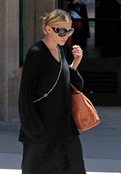 Mary-Kate Olsen wears a pair of unique sunglasses as she leaves her hotel.