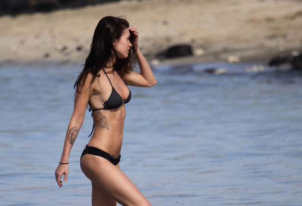 Megan Fox Megan Fox and husband Brian Austin-Green frolic in the surf.Megan is wearing her diamond engagement ring with her bikini and tattoos. .The ring is almost as big as her bikini!.