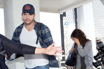 Mila Kunis Ashton Kutcher and Mila Kunis at LAX