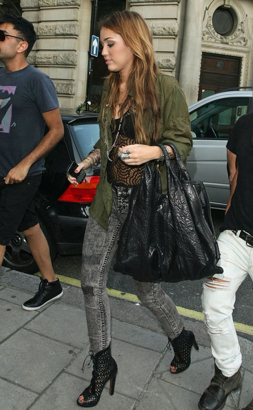 Miley Cyrus Miley Cyrus keeps her look edgy as she leaves her London hotel.