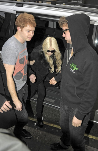 Taylor Momsen arrives waving at the BBC radio studios.