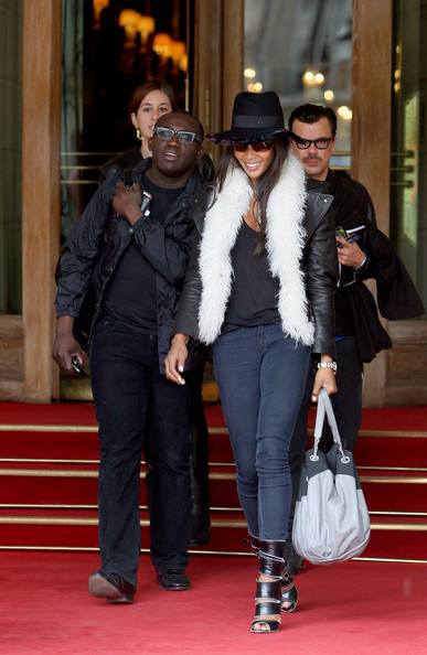 Naomi Campbell struts around Paris carrying a large Chanel purse.
