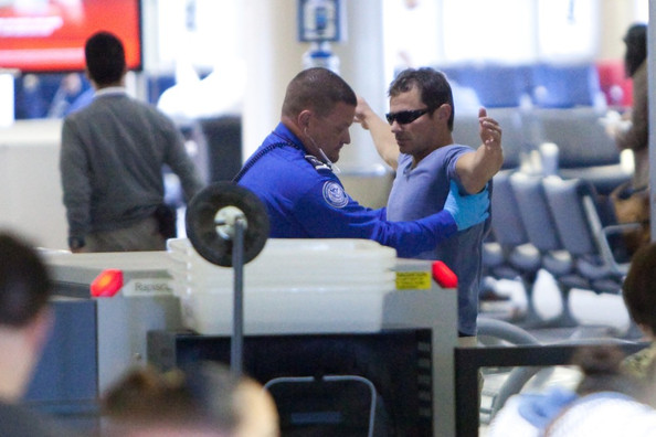 Nick Lachey Nick Lachey assumes the position as he is screened at TSA security preparing to depart LAX (Los Angeles International Airport).