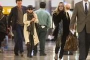 Mary Kate Olsen, her boyfriend Olivier Sarkozy, and her sister Ashley Olsen prepare to depart at LAX (Los Angeles International Airport).