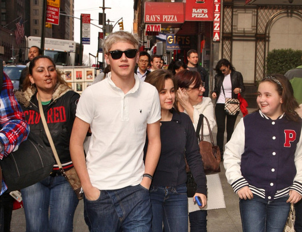 """Naill Horan of the British-Irish boy band """"One Direction"""" poses with fans and hams it up for the cameras as he walks through mid-town Manhattan."""