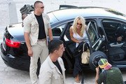Pamela Anderson arrives at Grand Hotel Avala by helicopter with her boyfriend Jamie Padgett and a team of security.
