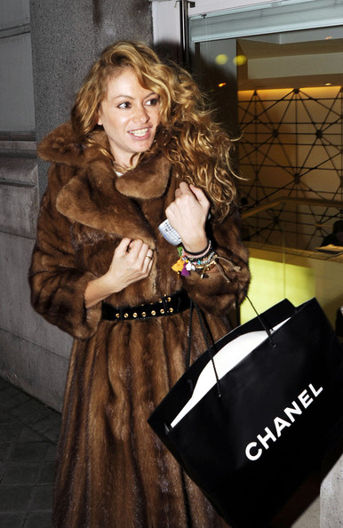 Spanish singer Paulina Rubio snuggles up to her big fur coat as she shops for Christmas presents at Chanel.