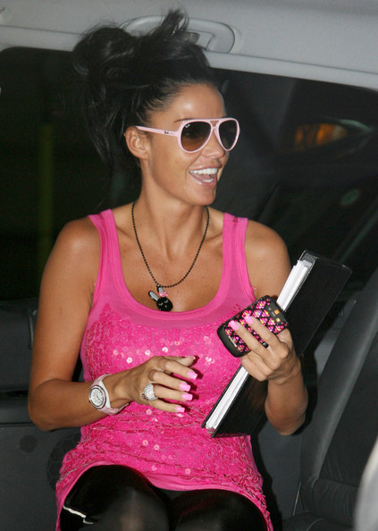 Katie Price (aka Jordan) arrives to her central London hotel wearing a bright pink sequined tank top.