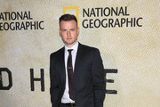 Alex Ross is seen arriving at the premiere of National Geographic's 'The Long Road Home' at Royce Hall in Los Angeles, California.