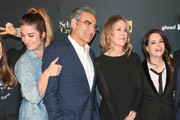 Annie Murphy, Eugene Levy, Catherine O'Hara and Emily Hampshire are seen attending the premiere of Pop TV's 'Schitt's Creek' season 4 at ArcLight Hollywood in Los Angeles, California.