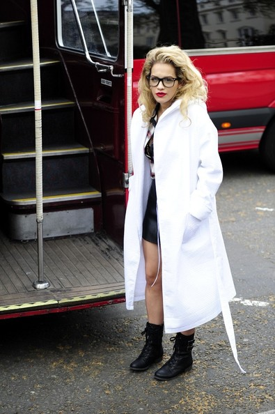 FOR USA SALES: Contact Randy Bauer (310) 910-1113 bauergriffinsales@gmail.com.FOR UK SALES: Contact Caroline 44 207 431 1598 MUST BYLINE: EROTEME.CO.UK.Rita Ora looks geeks chic in black rimmed eyeglasses, a low cut plaid shirt, with a black leather mini skirt as she holds a photo shoot on a red double decker bus.