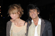 A loved up Ronnie Wood and girlfriend Ekaterina Ivanova giggle as they spend an evening out in Soho.