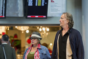 ****NO GERMANY / SWITZERLAND****.Roseanne Barr and longtime boyfriend Johnny Argent do some last minute shopping at LAX as they prepare for takeoff. Johnny is so tall he had to duck his head when exiting Hudson News.The pair lives on a 40-acre (macadamia) nut farm on Hawaii's Big Island, and as they prepare to film her new unscripted reality TV show, it certainly seems that Roseanne is dressed for the part.She is in the middle of a custody trial with her ex. Ben Thomasto that demanded Roseanne to foot the bill for his trips to Hawaii to visit their son, Buck.