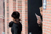 Ryan Gosling and Eva Mendes slip out the back door of their hotel and get into separate cars en route to JFK Airport. Once there Gosling hides his face behind a Famous Monsters magazine.