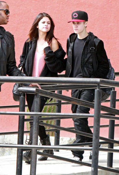 Selena Gomez Justin Bieber and Selena Gomez look tired as they arrive in Mexico. Selena flashes a ring on her engagement finger, one which she was not wearing when she boarded the flight in LA.NON- EXCLUSIVE December 07, 2011.