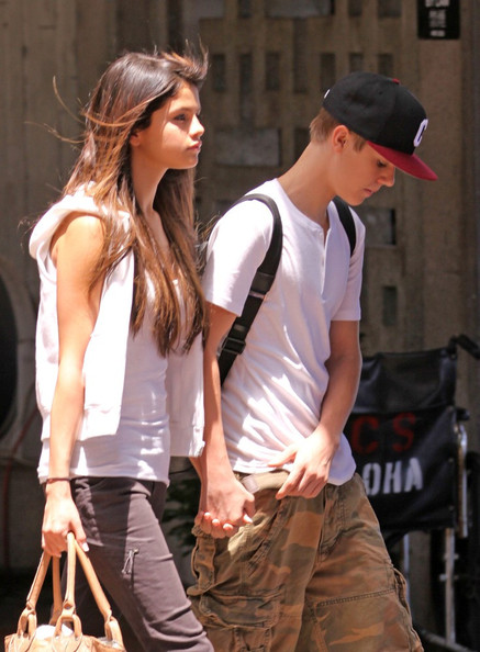 Selena Gomez Soon after landing in Hawaii, hand in hand Selena Gomez and Justin Bieber head for the beach.Justin in only board shorts reveals his tattoos.