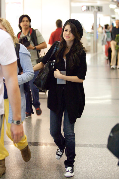 Selena Gomez Selena Gomez cracks up as she prepares to depart LAX (Los Angeles International Airport) with a huge smile on her face.