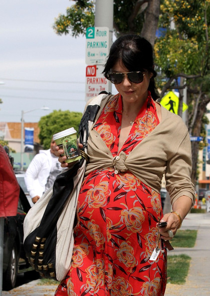 Selma Blair Selma Blair departs her favorite lunch spot, Urth Cafe in West Hollywood, wearing a brilliant red maxi dress.