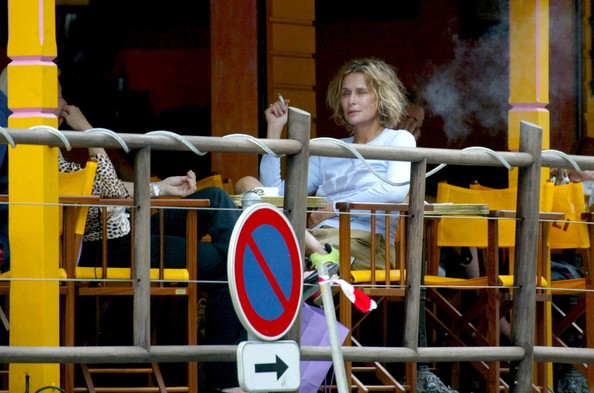 Lauren Hutton smoking a cigarette (or weed)