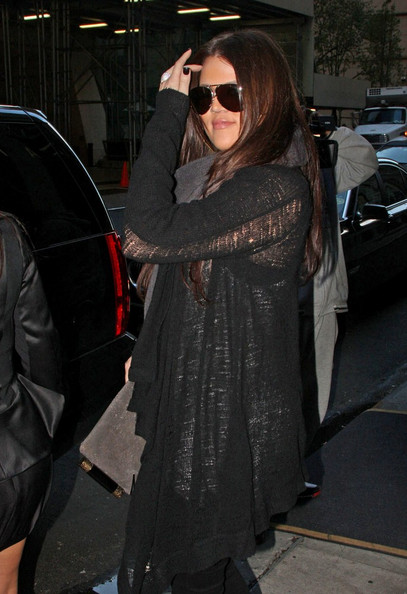 The Kardashian sisters, Kim, Kourtney, and Khloe, step out of their hotel to do some shopping, while Scott Disick stays back. The ladies return, do a wardrobe change and depart again.