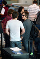 "Band/family members of Kings of Leon, Anthony ""Caleb"" Followill, Ivan ""Nathan"" Followill, Michael ""Jared"" Followill, and Cameron ""Matthew"" Followill prepare for their departing flight out of Los Angeles International airport (LAX)."