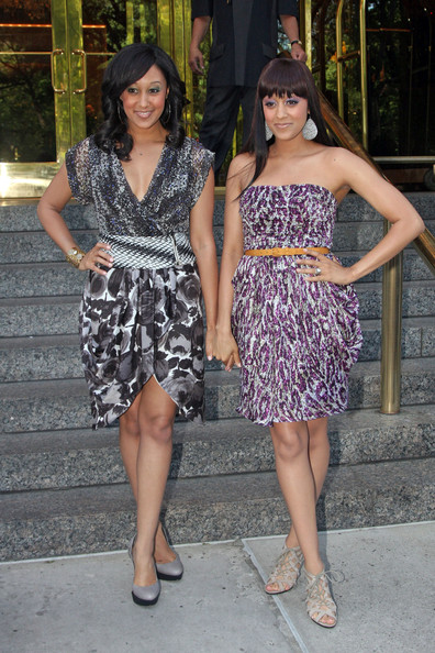 Tia Mowry Tia and Tamera Mowry get glam as they leave the Trump International Hotel and pose with fans.