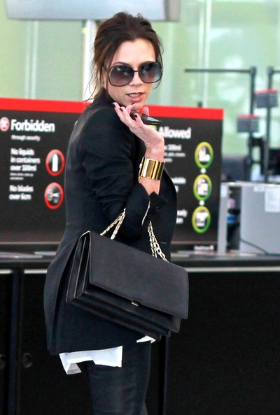 victoria beckham pregnant 2011 bump. Victoria Beckham who is four