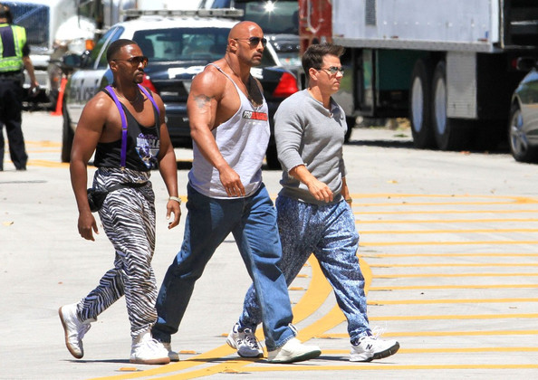 Mark Wahlberg, Dwayne 'The Rock' Johnson, and Anthony Mackie throw on their 90's duds and hop into a red Dodge sports car as they film a scene for 'Pain and Gain.'.