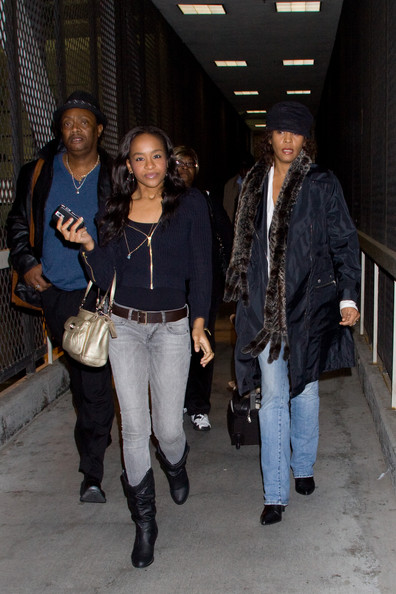 Whitney Houston Whitney Houston and daughter Bobbi Kristina arrive at LAX.