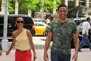 Will Smith and Jada Pinkett Smith head into an office building in Midtown.