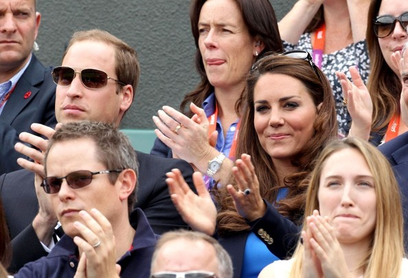 Prince William, Duke of Cambridge and Catherine, Duchess of Cambridge do the wave while they cheer on British tennis champ, Andy Murray as he competes in the mens quarter finals match during the 2012 London Summer Olympics.