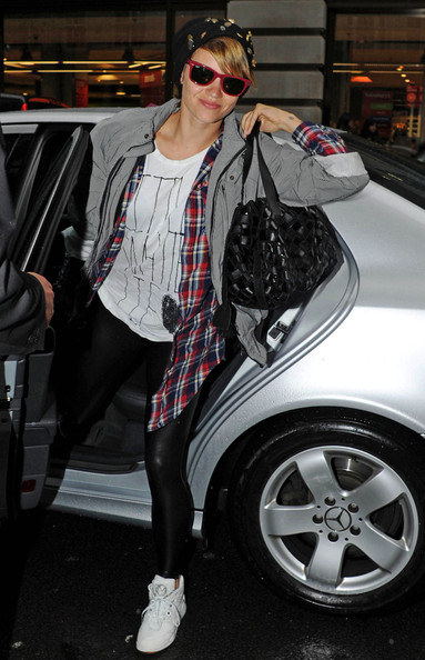 Former Pussycat Doll Kimberly Wyatt gets out of a car outside her hotel.