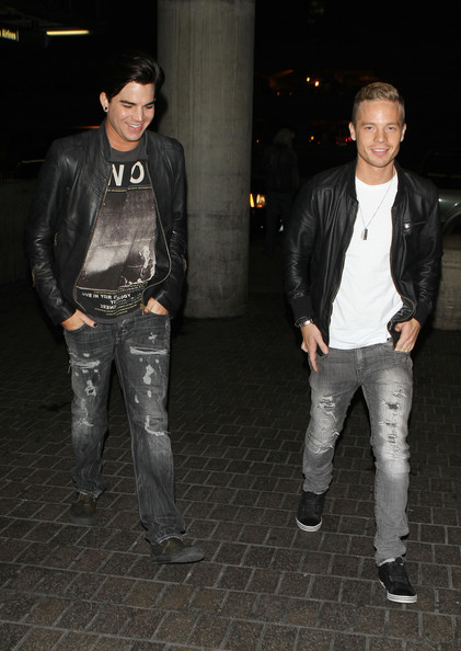 """American Idol"" star Adam Lambert and his boyfriend Sauli Koskinen arrive at LAX airport to catch a flight out of Los Angeles."