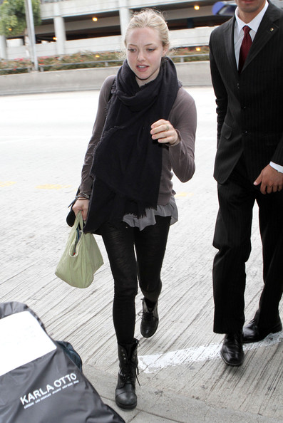 Actress Amanda Seyfried arriving for a flight at LAX airport in Los Angeles, CA. Amanda's boyfriend Ryan Phillippe arrived for a flight also a little while later.