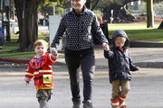 'Parks And Recreation' actress Amy Poehler drops off her boys Abel and Archie at school in Beverly Hills, CA on October 11, 2012. The boys are all dressed up in their rainy day clothes and they splash in the puddles while they walk along the sidewalk.