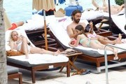 Professional Italian soccer player Andrea Pirlo enjoys a relaxing day at the poolside with his family in Miami, Florida on June 19, 2016.  The group relaxed and soaked up some sun before walking together.  Andrea snuck a quick kiss to his girlfriend Valentina Baldini.