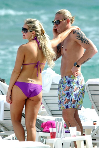 Voronin and wife Yulia were seen on the second day of their beach