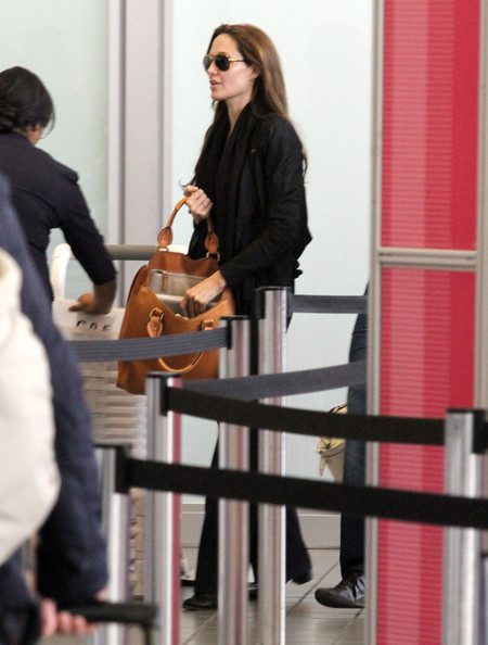 Angelina Jolie Actress Angelina Jolie and her bodyguard arriving for a flight at LAX airport in Los Angeles, CA.