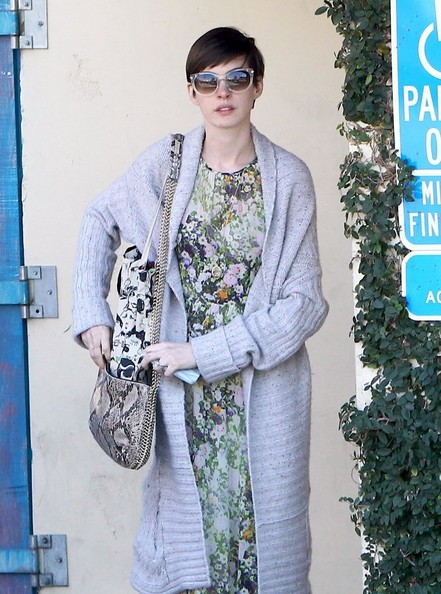 """Les Miserables"" actress Anne Hathaway attends a breakfast business meeting in Brentwood, California on February 26, 2013."