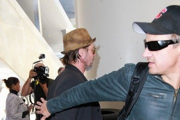 Brad Pitt Brad Pitt and Jeremy Renner Touch Down at LAX