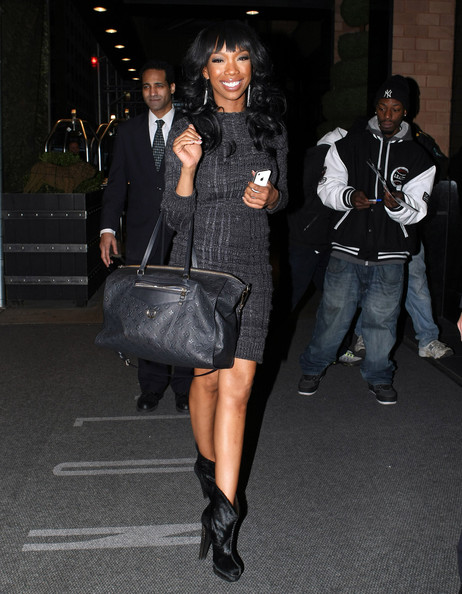 Brandy Singer Brandy looks stunning in a form fitting grey dress as she goes out and about in NYC, NY on January 10, 2012.