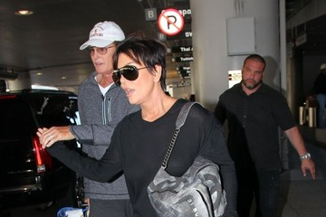 Bruce Jenner Kris and Bruce Jenner Hold Hands at LAX