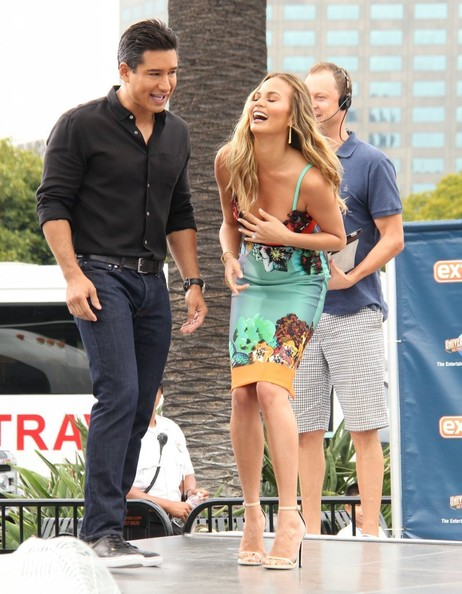 She laughs hard with Mario Lopez.