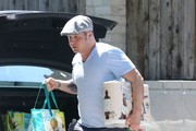 Reality star Chaz Bono returns from grocery shopping in West Hollywood, California on July 3, 2014. Chaz has reportedly lost an amazing 85 pounds since 2012!