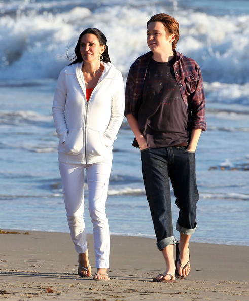 Actress Courteney Cox and Dan Byrd (who plays her son Travis) frolicking on the beach on the set of 'Cougar Town' in Pacific Palisades, CA. The two built a sand castle which the end up destroying and then they fly a kite.