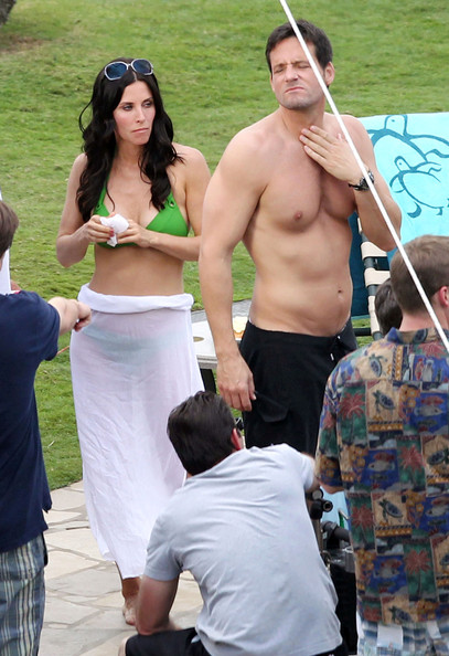 Actress Courteney Cox shows off her bikini body on the set of 'Cougar Town' in Hawaii. Also on set is Christa Miller and Josh Hopkins.
