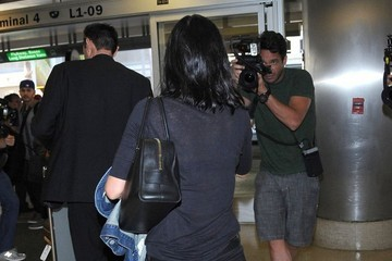 Courteney Cox Courteney Cox and Johnny McDaid at LAX